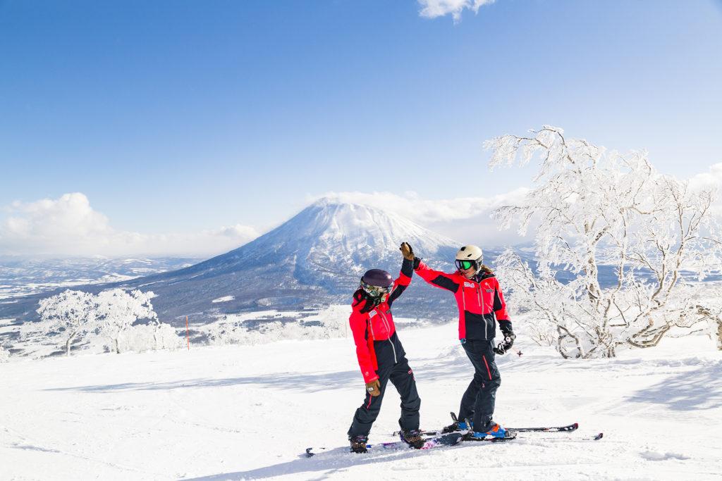 Skiers and snowboarders enjoying the stunning snow in Niseko