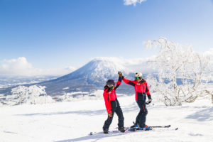 Skiers and snowboarders enjoying the stunning snow in Niseko