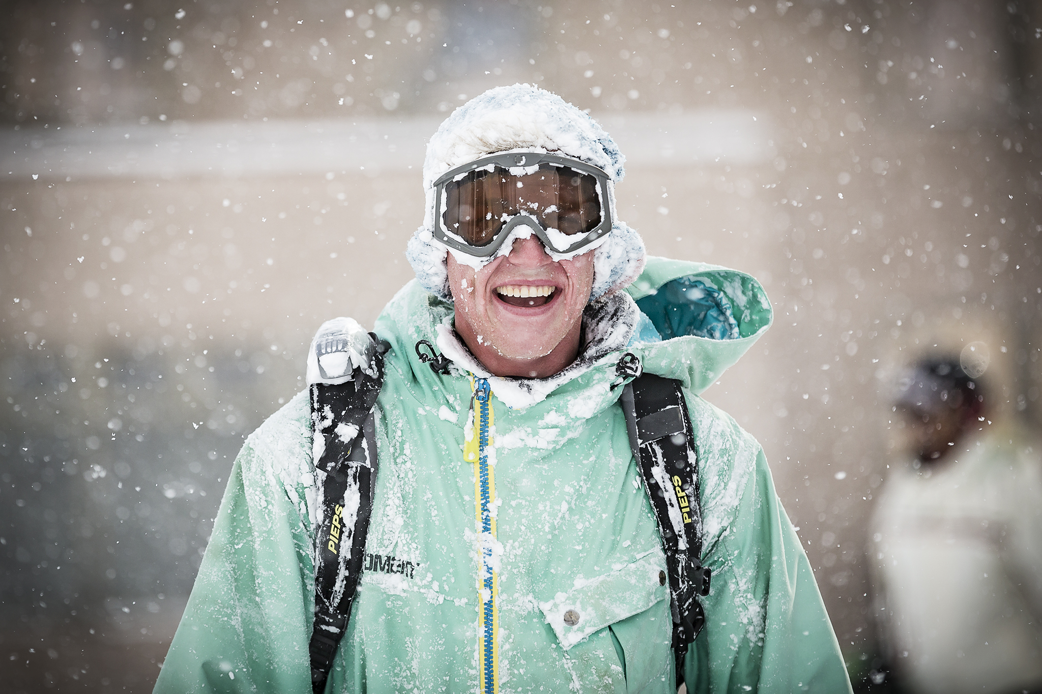 A happy snowboarder covered in powder snow in Niseko