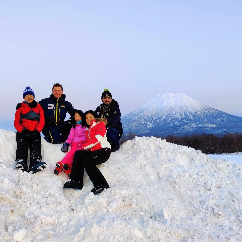Hokkaido Ski Club ski instructors and guests with Mount Yotei
