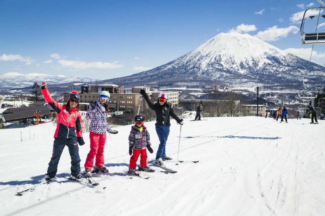Family enjoying spring skiing in Niseko with Hokkaido Ski Club