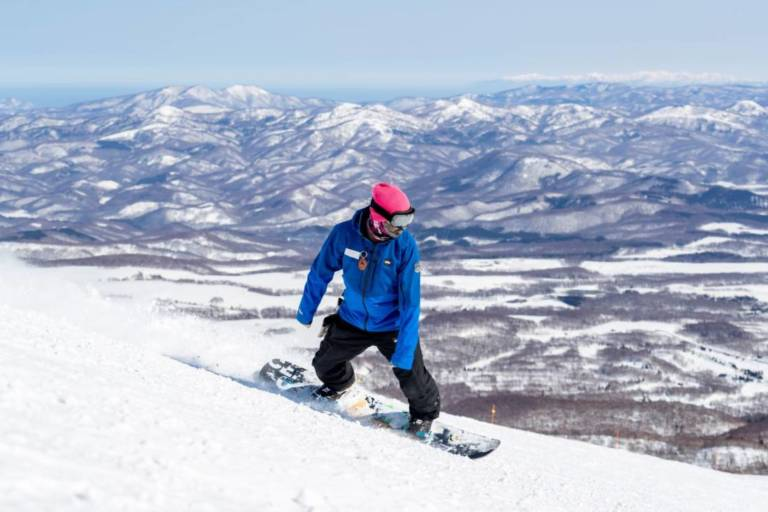 Snowboard instructor shows how to snowboard