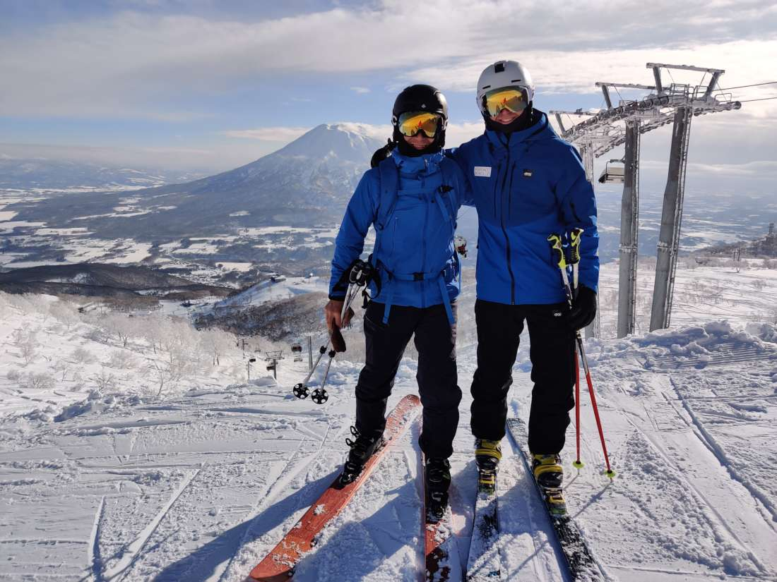 Hokkaido Ski Club ski instructor with guest at the top of the King hooded quad chairlift