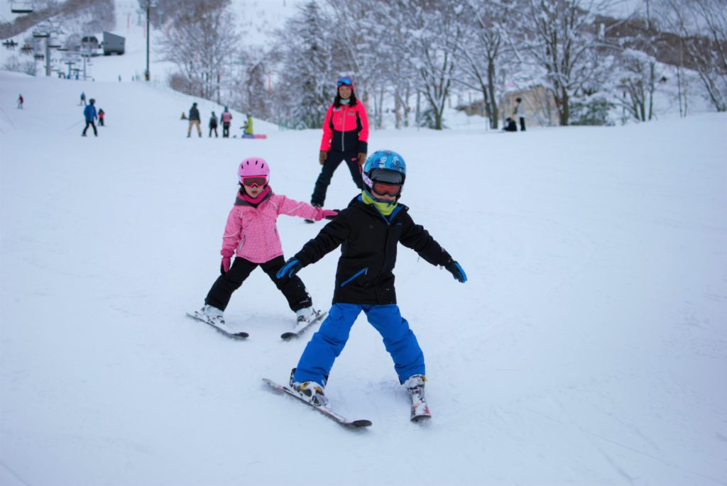 Children enjoying skiing and having fun