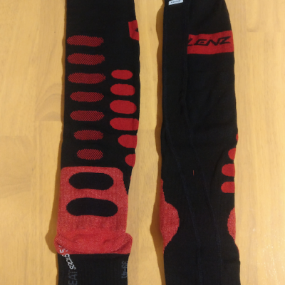 Heated sock with battery attachment