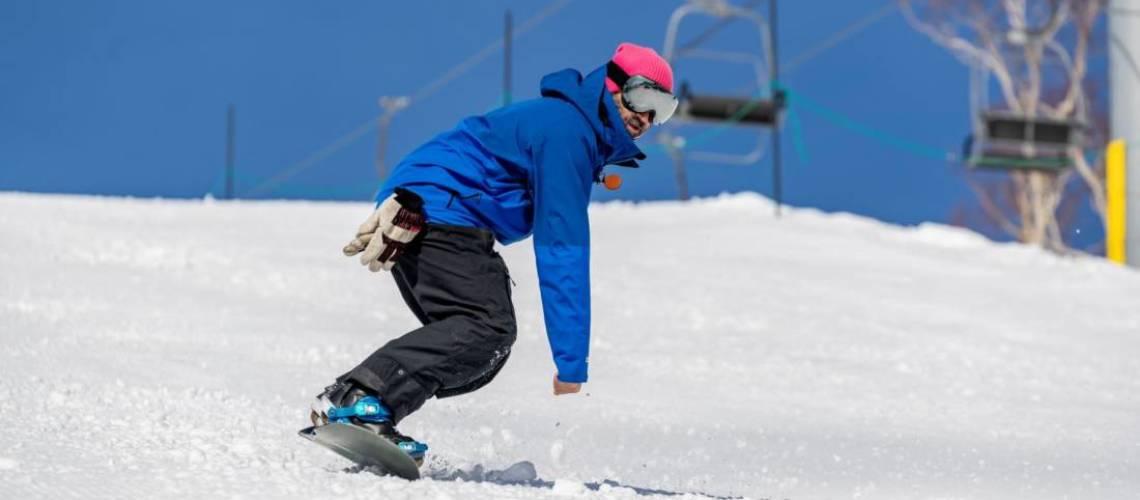 Snowboard instructor snowboarding